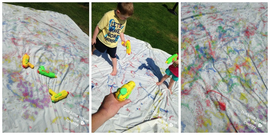 Painting with Water Pistols - More Messy Outdoor Summer Art Fun! - Our Little House in the Country #waterguns #waterpistols #summer #kidsactivities #artforkids